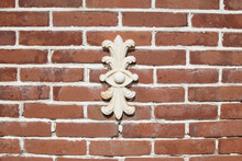 White Cast Iron Cramp In A Dutch Brick Wall. March, Netherlands.