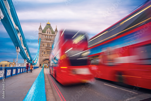 Fotografie, Obraz view of Tower Bridge with fast moving double decker bus
