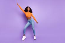 Photo Of Cute Charming Dark Skin Woman Dressed Orange Crop Top Dancing Isolated Purple Color Background