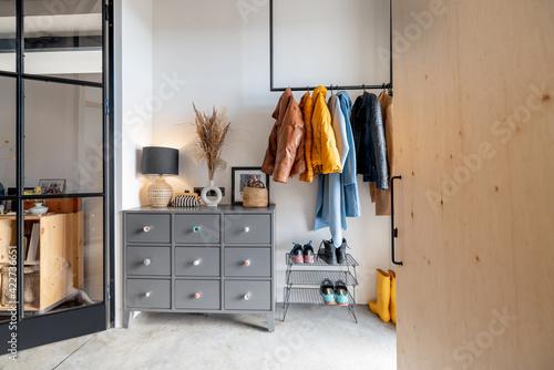 Billede på lærred House hallway interior with clothes and furniture