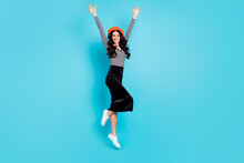 Full Length Portrait Of Astonished Pretty Person Raise Hands Celebrate Isolated On Blue Color Background