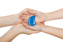 A Drop Of Water In The Palms Of Four Hands On A White Background, The Concept Of Preserving Clean Water On The Planet