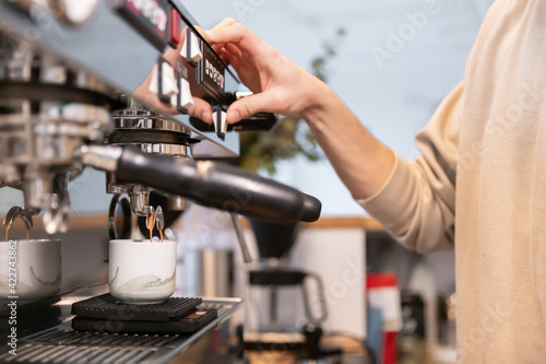 Tela Barista making coffee latte art with espresso machine in cafe