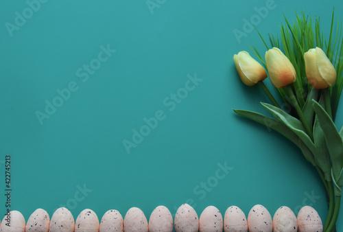 Fototapeta Small eggs and tulips on violet background obraz