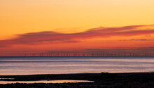 Dusk Light From Hope Gap Seaford Head With Rampion Offshore Wind Farm On The Horizon Off The East Sussex Coast South East England