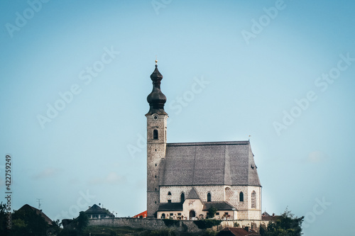 ancient Christian church on a raised rock as a dominant feature of Christianity in the Austrian lands near the city of Salzburg Fototapet