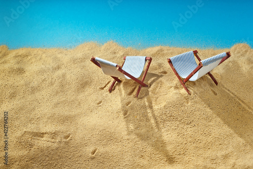 Foto Beach chairs on the sand