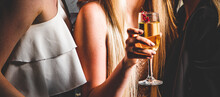 Glass Of Champagne In Woman Hand At A Party