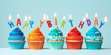 Row Of Orange And Blue Birthday Cupcakes