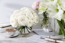 A Bouquet Of White Roses In A Round Glass Vase On A Table With A Cup Of Tea And A Book. Copy Space.