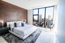 Modern And Luxurious Bedroom With White Ceiling And Wood Accents With Views Of Tokyo Skyline, Particularly Minato Ward. Condo Or Hotel Accomodation.