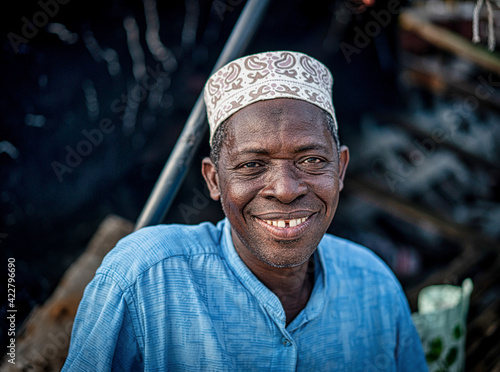 Senior man sitting on coast smiling nice with hat , High quality photo