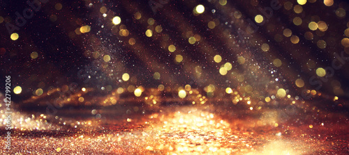 Fototapeta background of abstract gold and black glitter lights. defocused obraz