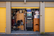 Contents Of A House Packed Into A Storage Unit With The Door Open
