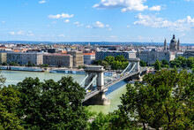 Landscape With Old Historical Széchenyi Chain Bridge Over Danube And Clear Blue Sky In Budapest City, Hungary, In A Sunny Summer Day.