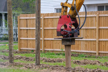 Vibratory Pile Driver Attachment In Action At New Residential Construction Site