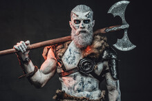 Northern Warrior With Pale Skin In Twilight With Two Handed Axe
