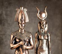 Egyptian Pharaoh Tutankhamun And Isis On A Brown Background.