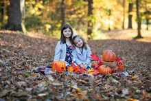 2 Children In The Park With Pumpkins.
