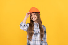 Teen Girl In Helmet. Builder Kid In Checkered Shirt. Building And Construction Concept.