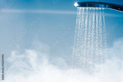Fotografering shower with flowing water and steam