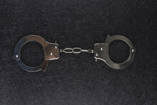 Closeup Shot Of Handcuffs Isolated On Black Background