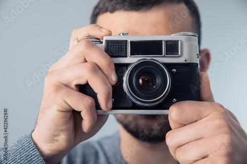 man holding vintage camera