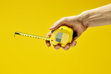 Cropped Male Using Yellow Tape Measure Copy Space