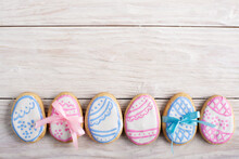 Easter Frosted Cookies In Shape Of Egg On White Wooden Table Background Flat Lay Horizontal Mockup With Copy-space