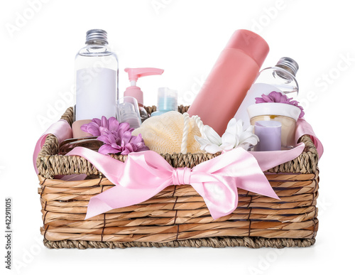 Fotografiet Gift basket with cosmetics on white background
