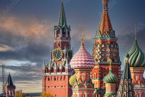 Fototapeta St. Basil's Cathedral and Spassky Tower on Red Square in Moscow. Orthodox church and architectural masterpieces of Moscow. Most famous sights of Russia. Life before pandemic COVID-19 obraz