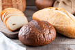 Assortment of baked bread on wooden table