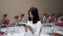 Christian Women Pray And Hold The Scriptures
