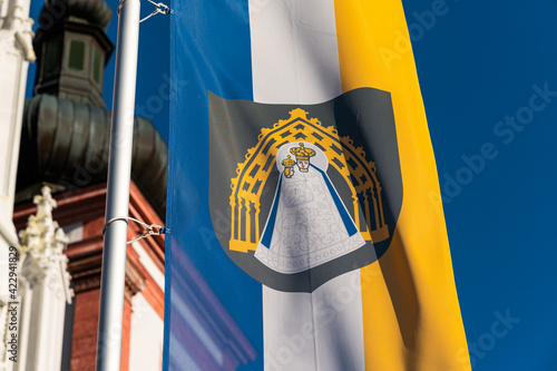 Flag of Mariazell in front of church Fotobehang