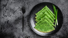 Green Vegan Crepes With Spinach On Dark Background. Healthy Breakfast, Vegetarian Food, Banner, Menu Recipe Place For Text, Top View