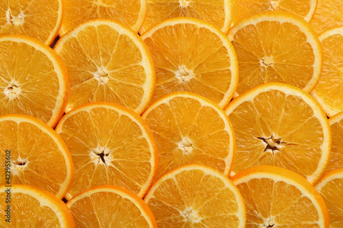 Slices of delicious oranges as background, closeup Wallpaper Mural