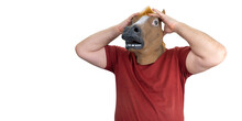 Man In A Horse Mask Isolated On A White Background. A Man Grabs His Head, The Concept Of Hopelessness And Doom