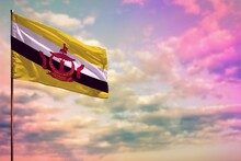 Fluttering Brunei Darussalam Flag Mockup With The Space For Your Content On Colorful Cloudy Sky Background.