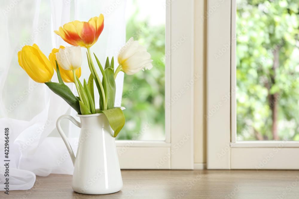 Fototapeta Beautiful fresh tulips on window sill indoors. Spring flowers