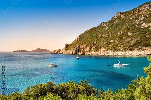 Fototapeta Boats in bay near Porto Timoni beach on Corfu island in Greece