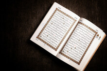 An Open Page Of Quran Showing Surah Al Baqarah, Ayah 177 - 186 On Brown Background. Quran Is An Islamic Holy Book