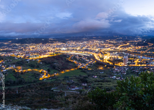 Ourense town lights up at sunset. Ourense is the capital of Galicia, Autonomous community in the Northwest of Spain.