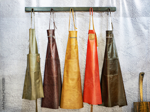 Foto Leather aprons for kitchen and workshop
