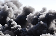 Burning Chemical Fire In An Automobile Junkyard With Billowing Black Clouds