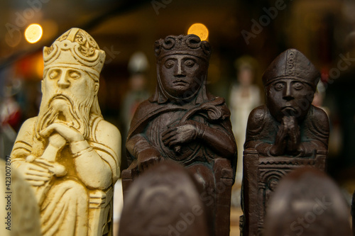Obraz na plátně Carved wooden chess pieces closeup, small figures of king, queen and bishop in w