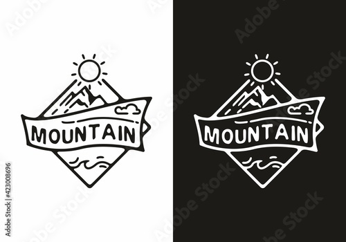 Black and white mountain badge with ribbon