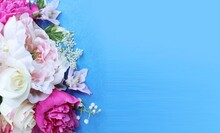 White And Pink Peonies In A Festive Bouquet On A Blue Background. A Luxurious Floral Arrangement. Background For A Greeting Rollout.