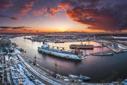 Wallpaper Mural Ship repair and maintenance docks in beautiful sunset colors