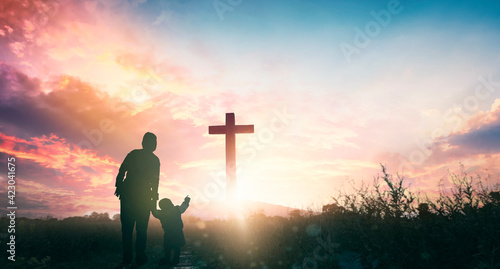 Obraz na plátně Parents and children worship on the cross background