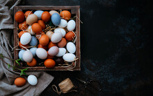 Background With Easter Eggs In The Vintage Wooden Box On Rustic Background. Easter Background With Eggs And Spring Branches.Top View With Copy Space.